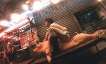 Takeshi Kaneshiro on the back of a pig in Fallen Angels