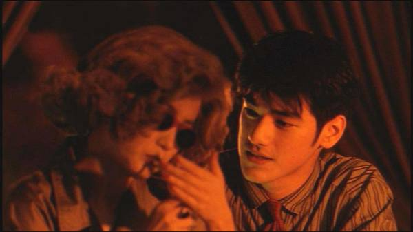 Takeshi Kaneshiro with Brigitte Lin Ching Hsia in Chungking Express
