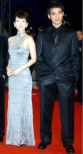 Red carpet with Takeshi Kaneshiro in all black and Zhang Ziyi in a dress