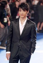 Takeshi Kaneshiro in a black elegant suite with his short wispy hairstyle
