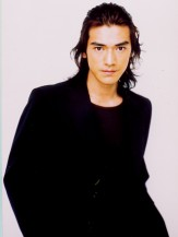 Tawainese, Japanese actor Takeshi Kaneshiro with layered long hair pulled back