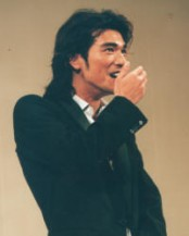 Takeshi Kaneshiro laughing with hand covers his mouth