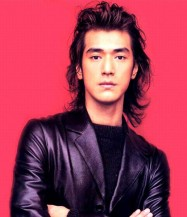 Takeshi Kaneshiro with 80s hairstyle with bright pink back ground