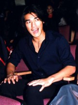 Image of Takeshi Kaneshiro in dark blue shirt