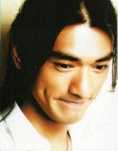 Takeshi Kaneshiro with long hair and long  side dimpling bangs