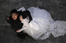 Takeshi Kaneshiro in K20 holding woman in white dress.jpg
