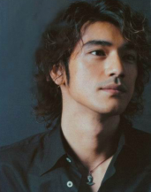 Takeshi Kaneshiro with curly hairstyle and long curly bangs