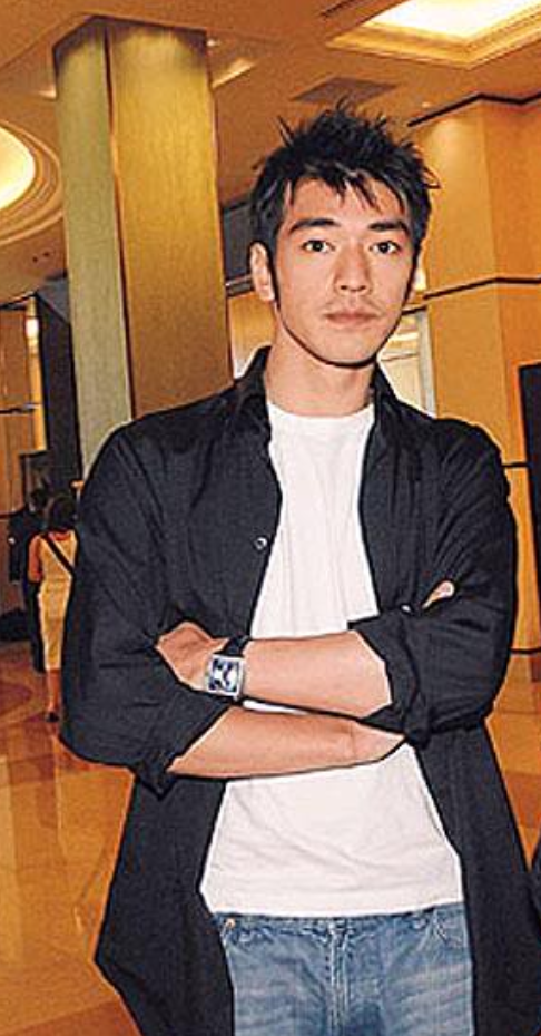 Takeshi Kaneshiro Picture With His Spiky Hairstyle Looking Straight