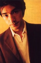 Takeshi Kaneshiro with mediu hairstyle_wearing elegant brown jacket