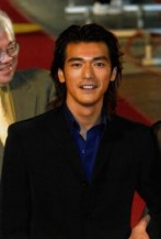 Takeshi Kaneshiro with layered long hairstyle in black elegant black jacket